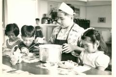 Boy Serving Children