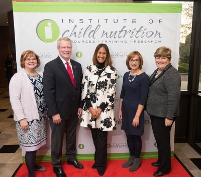 (l to r) SNA President, Gay Anderson; UM Chancellor Glen Boyce; ICN Executive Director, Dr. Aleshia Hall-Campbell; USDA Deputy Administrator, Cindy Long; and SNA CEO, Patricia Montague